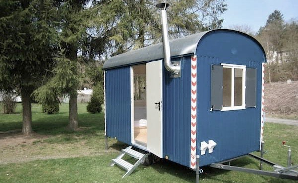 Blue sidetrailer with could be reconstructed to a hen house.